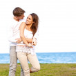 Young Couple Enjoying Themselves by the Beach — Stock Photo