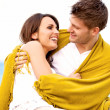 Royalty-Free Stock Photo: Couple Wrapped in Blanket Looking at Each Other