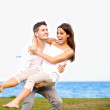 Cute Guy Carrying His Beautiful Girlfriend — Stock Photo #11863178