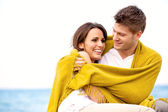 Couple Wrapped with Blanket Embracing — Stock Photo