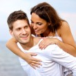 Happy Handsome Young Man Piggybacking His Girlfriend — Stock Photo