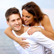 Happy Handsome Young Man Piggybacking His Girlfriend — Stock Photo #11981017