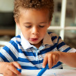 Adorable Little Boy Draws with Crayons — Stock Photo