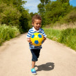 Stock Photo: Little Kid Holding a Ball