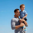Cute Toddler Being Carried by Dad — Stock Photo #12104035