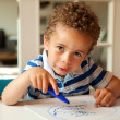 Charming Little Boy Busy Coloring at His Desk — ストック写真