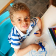 Stock Photo: Preschooler Playing with a Box of Crayons