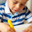 Young Child Holding a Yellow Crayon — Stock Photo