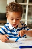 Adorable Little Boy Draws with Crayons — Foto de Stock