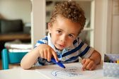 Charming Little Boy Busy Coloring at His Desk — Stock Photo