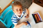 Preschooler Playing with a Box of Crayons — Stock Photo