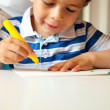 Stock Photo: Young Boy Busy Doing His Art Activity