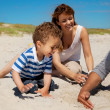 Young Family Enjoying Summer on a Beach — Stock Photo