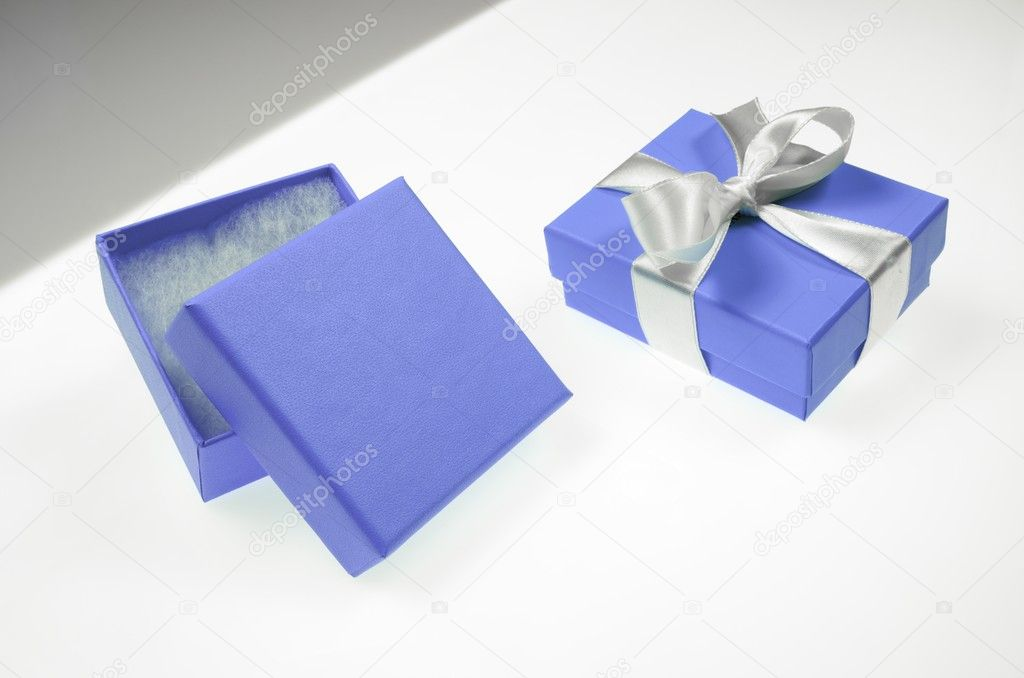 Two small blue box tied with a white ribbon — Stockfoto #11156685
