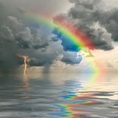Rainbow over ocean — Stockfoto