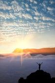 A man at mountain top — Stock Photo