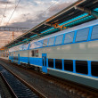 Train at railway station — Stock Photo