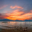 Sunrise on Lake with majestic clouds — Stock Photo