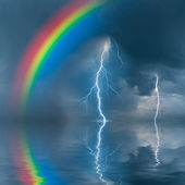 Colorful rainbow over wate — Stock Photo