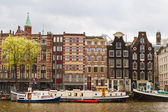 Street with traditional buildings in Amsterdam — Stock Photo