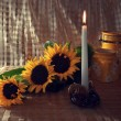 Still life with sunflowers and a candle — Stock Photo