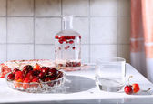 A dish with cherries and drinks — Stock Photo