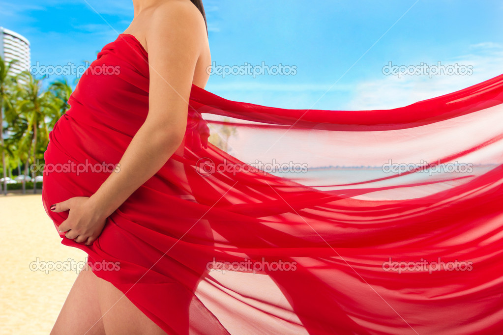 Abdomen a young pregnant woman wrapped in cloth — Foto Stock #10952852