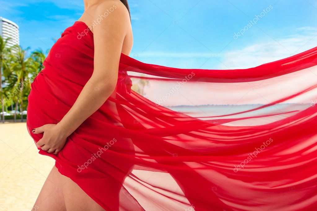 Abdomen a young pregnant woman wrapped in cloth — Foto de Stock   #10952852