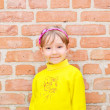 The Child on background brick wall — Stock Photo #10858254