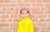 The Child on background brick wall — Stock Photo