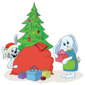 White Rabbits, Christmas tree and gifts — Stock Photo