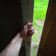 Hand of a man opening old door — Stock Photo