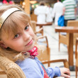 Portrait of a little blond girl in cafe — Stock Photo