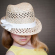Stock Photo: Little girl wearing straw hat