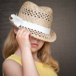 Stock Photo: Portrait of little blond girl with hat