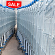 Supermarket shopping carts with SALE text label — Stock Photo