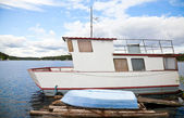 Small white moored boat — Stock Photo