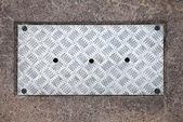 Closeup texture of diamond metal panel with holes — Stock Photo