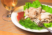 Sliced backed chicken with greens — Stock Photo
