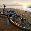 Bicycle lying on the beach — Stock Photo