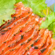Smoked salmon slices served with salad and dill - Stock Photo