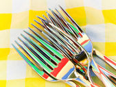 Set of forks with nice colorful reflection — Stock Photo