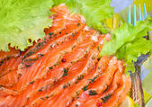 Smoked salmon slices served with salad and dill — Stock Photo