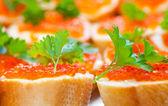 Red caviar sandwiches — Stock Photo