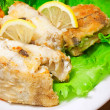 Fried haddock fish with vegetables and greens - Stock Photo