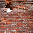 Brick wall texture with hole — Stock Photo