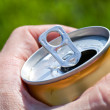 Can of beer in a man's hand — Stock Photo