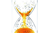 Hourglass with a red bubbles — Stock Photo