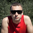 Portrait of young man in black sunglasses — Stock Photo #11856105