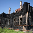 Burnt old wooden building — Stock Photo